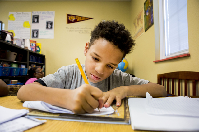 Fourth-grader Devin Harris-Latty, 9, works on his writing homework at the 100 Academy of Excellence, 2341 Comstock Drive, Wednesday, Nov. 30, 2016, North Las Vegas. (Elizabeth Brumley/Las Vegas Re ...