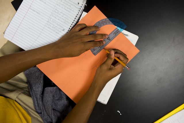 An eighth-grader works on his schoolwork during his science class, at the 100 Academy of Excellence, 2341 Comstock Drive, Wednesday, Nov. 30, 2016, North Las Vegas. (Elizabeth Brumley/Las Vegas Re ...