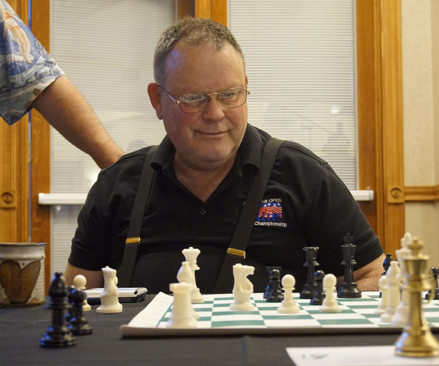 Las Vegas Chess Center member David Sletten, 60, waits to hear what chess grandmaster Timur Gareyev's next move will be at the UNLV Foundations Building in Las Vegas on December 3, 2016. Sarah Cor ...