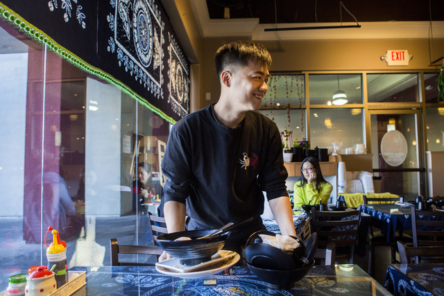 Jason Chan, server at Yunnan Tasty Garden, a restaurant in the Las Vegas Asian Plaza, 5115 Spring Mountain Rd, Las Vegas, clears a table, Friday, Dec. 2, 2016. Elizabeth Page Brumley/Las Vegas Rev ...