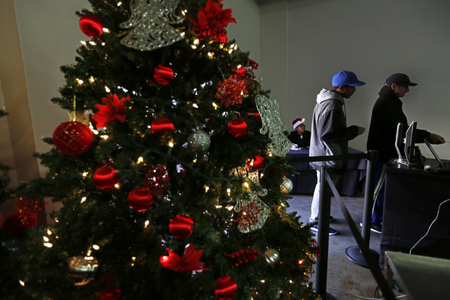Guests arrive at Catholic Charities of Southern Nevada in Las Vegas, Sunday, Dec. 25, 2016, for Christmas dinner. Catholic Charities of Southern Nevada serves Christmas meals to less fortunate peo ...