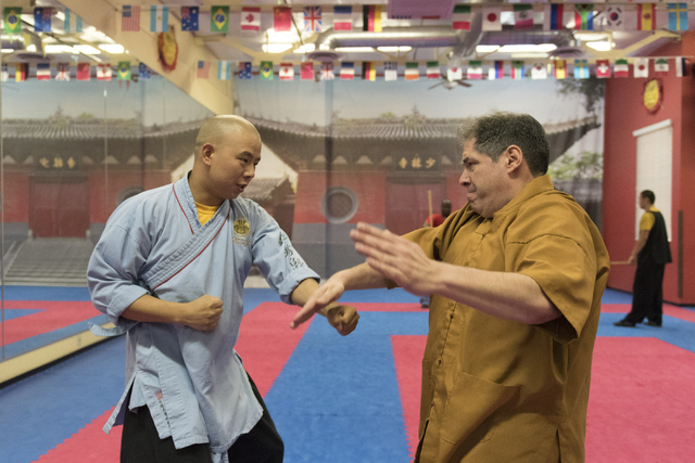 Rabbi Felipe Goodman, right, is given a kung fu lesson from shifu Shi Xing Wei at Shaolin Kungfu Chan in Las Vegas Friday, July 29, 2016. Rabbi Goodman does kung fu as a way to relieve workplace s ...