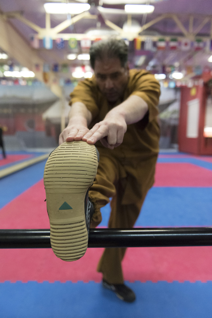 Rabbi Felipe Goodman stretches during a kung fu lesson at Shaolin Kungfu Chan in Las Vegas Friday, July 29, 2016. Rabbi Goodman does kung fu as a way to relieve workplace stress. (Jason Ogulnik/La ...