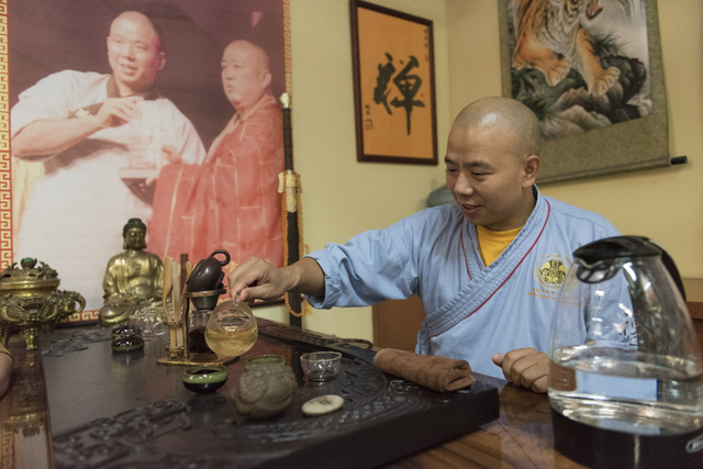 Shifu Shi Xing Wei prepares green tea during a break while giving a kung fu lesson to Rabbi Felipe Goodman at Shaolin Kungfu Chan in Las Vegas Friday, July 29, 2016. (Jason Ogulnik/Las Vegas Revie ...