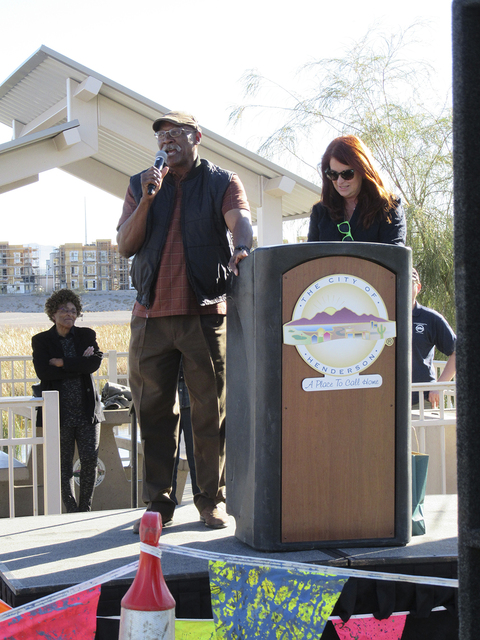 J.T. Reynolds is presented the Heart of the City Award by Henderson City Councilwoman Debra March at the Color Me Kind 5K. He was recognized for his community service. (Special to View)