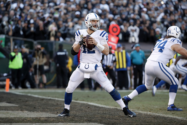 Indianapolis Colts quarterback Andrew Luck (12) passes during the second half of an NFL football game against the Oakland Raiders in Oakland, Calif., Saturday, Dec. 24, 2016. (AP Photo/Tony Avelar)