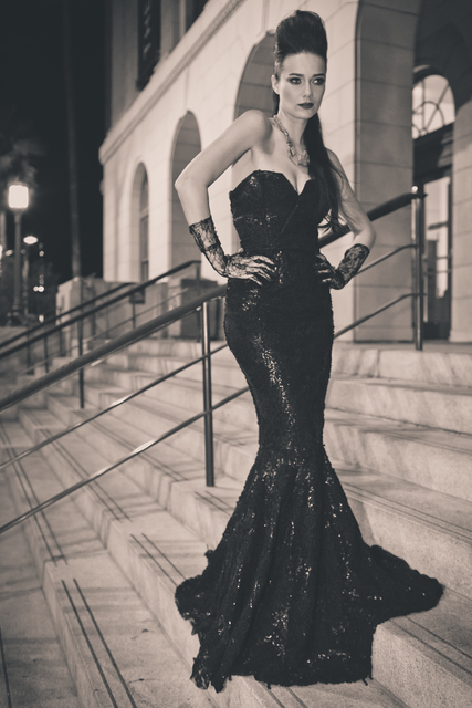 """A model stands outside the Mob Museum in downtown Las Vegas wearing a dress by Ermelinda Manos and a gold necklace from Manos' mother's closet in an image from the book """"Lost in Las Vegas."""" Courtesy."""