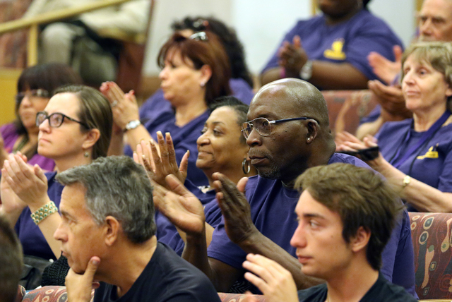 SEIU Local 1107 members and supporters wearing purple shirts show their support after SEIU Local 1107 President Martin Bassick speaks at the County Commission meeting at Clark County Government Ce ...