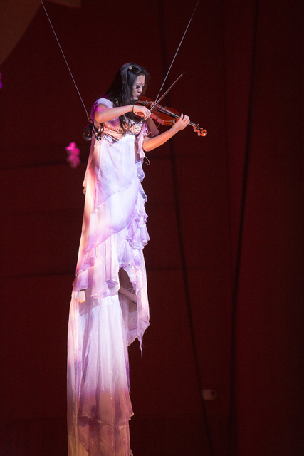 """""""Flying violinist"""" Veronica Gan ascends as she plays """"Silent Night"""" during the Cirque Musica Holiday Spectacular tour, which visits the Orleans Arena on Wednesday. (TCG Entertainment)"""