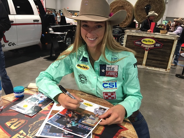Barrel racing star Sarah Rose McDonald fought through laryngitis to do her autograph signing session with a smile Saturday at Cowboy Christmas. (Patrick Everson/Las Vegas Review-Journal)