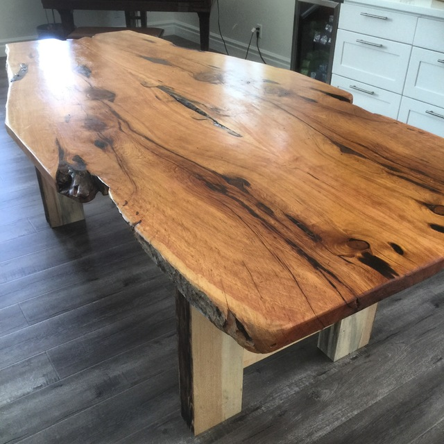 COURTESY RECLAIMED SECRETS This custom-made kitchen island acts as a foundation for holiday gatherings.