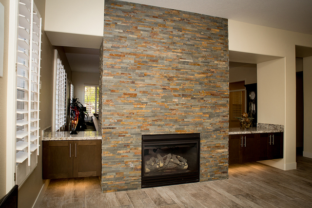 Homeowner Gordon Miles' first change was to eliminate a wall separating the living room from the kitchen/great room and install under-lit, counter-height cabinets on either side of the existing fi ...
