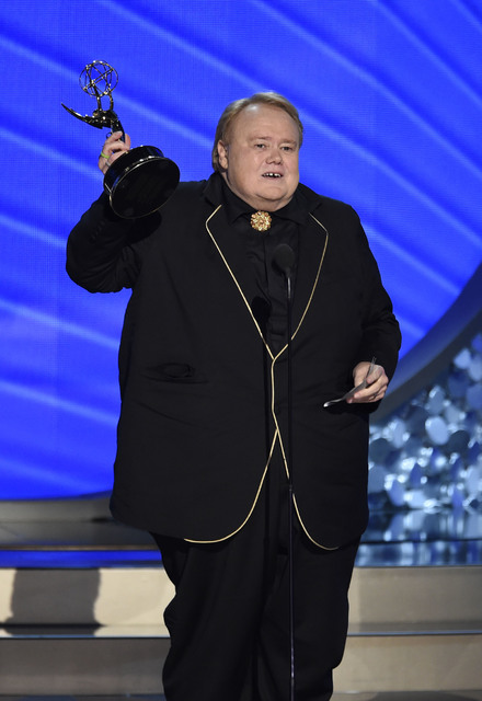 """Louie Anderson accepts the award for outstanding supporting actor in a comedy series for """"Baskets"""" at the 68th Primetime Emmy Awards on Sunday, Sept. 18, 2016, at the Microsoft Theater in Los  ..."""
