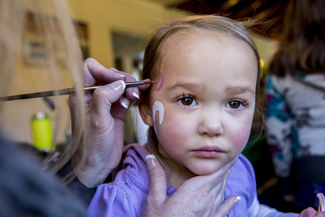 Jordan Love, 2, gets her cheek painted during the Cowboy Christmas and Classic Car Show, Sat, Dec. 3, 2016, at Floyd Lamb Park, 9200 Tule Springs Road, Las Vegas. (Elizabeth Page Brumley/Las Vegas ...