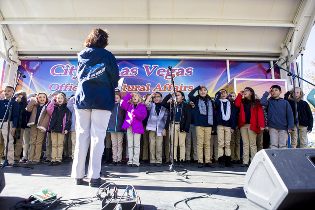 Students from Henry & Evelyn Bozarth Elementary School preforms a holiday song during the Cowboy Christmas and Classic Car Show, Sat, Dec. 3, 2016, at Floyd Lamb Park, 9200 Tule Springs Road,  ...