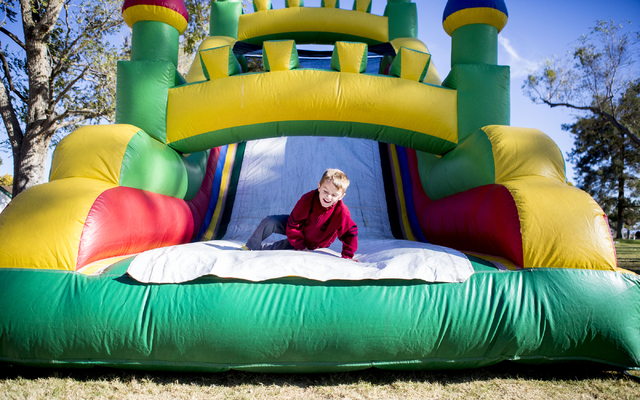 Anderson, 6, slides down a blow up during the Cowboy Christmas and Classic Car Show, Sat, Dec. 3, 2016, at Floyd Lamb Park, 9200 Tule Springs Road, Las Vegas. (Elizabeth Page Brumley/Las Vegas Rev ...