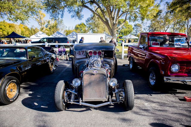 People look at an array of different cars during the Cowboy Christmas and Classic Car Show, Sat, Dec. 3, 2016, at Floyd Lamb Park, 9200 Tule Springs Road, Las Vegas. (Elizabeth Page Brumley/Las Ve ...