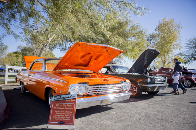 People looks at an array of different cars during the Cowboy Christmas and Classic Car Show, Sat, Dec. 3, 2016, at Floyd Lamb Park, 9200 Tule Springs Road, Las Vegas. (Elizabeth Page Brumley/Las V ...
