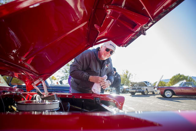 Pastor Rob Wright cleans his 1956 Chevrolet 150 Sedan during the Cowboy Christmas and Classic Car Show, Sat, Dec. 3, 2016, at Floyd Lamb Park, 9200 Tule Springs Road, Las Vegas. (Elizabeth Page Br ...