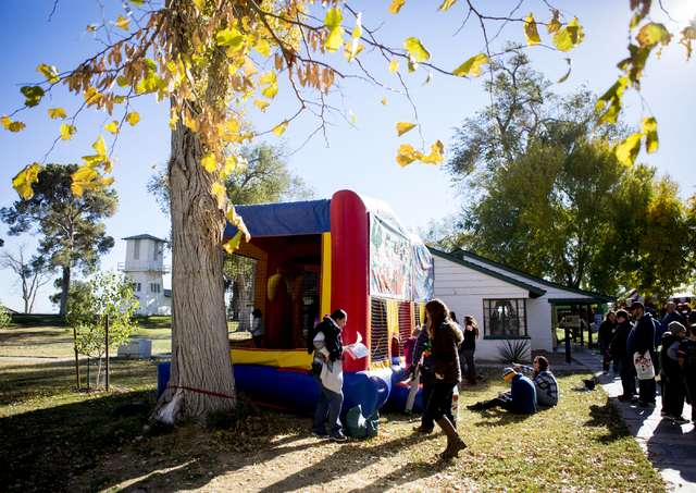 People enjoy jump houses during the Cowboy Christmas and Classic Car Show, Sat, Dec. 3, 2016, at Floyd Lamb Park, 9200 Tule Springs Road, Las Vegas. (Elizabeth Page Brumley/Las Vegas Review-Journa ...