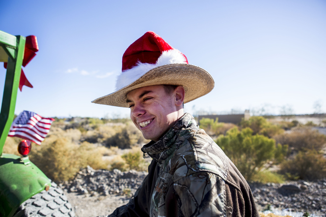 Alec Joy, volunteer, helps conduct a hay ride during the Cowboy Christmas and Classic Car Show, Sat, Dec. 3, 2016, at Floyd Lamb Park, 9200 Tule Springs Road, Las Vegas. (Elizabeth Page Brumley/La ...