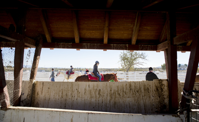 People enjoy free horseback rides during the Cowboy Christmas and Classic Car Show, Sat, Dec. 3, 2016, at Floyd Lamb Park, 9200 Tule Springs Road, Las Vegas. (Elizabeth Page Brumley/Las Vegas Revi ...