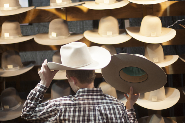 Chase Webster, 13, tries on a hat at the Cowboy Christmas gift show in the south halls of the Las Vegas Convention Center on Sunday, Dec. 4, 2016, in Las Vegas. (Rachel Aston/Las Vegas Review-Jour ...