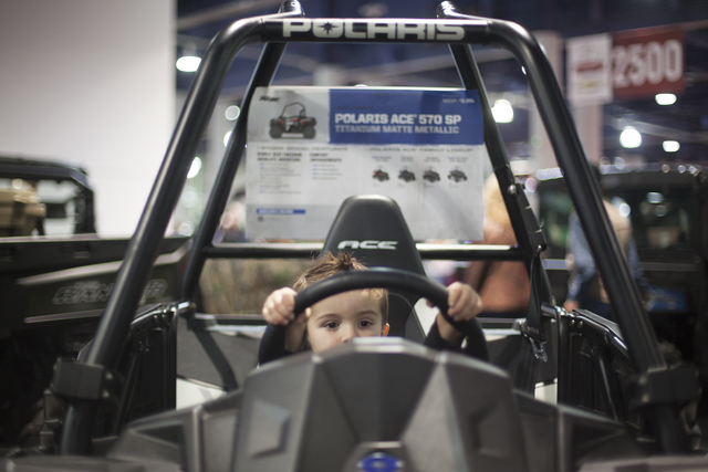 Jase Dudley, 3, plays in an off-road vehicle at the Cowboy Christmas gift show in the south halls of the Las Vegas Convention Center on Sunday, Dec. 4, 2016, in Las Vegas. (Rachel Aston/Las Vegas  ...
