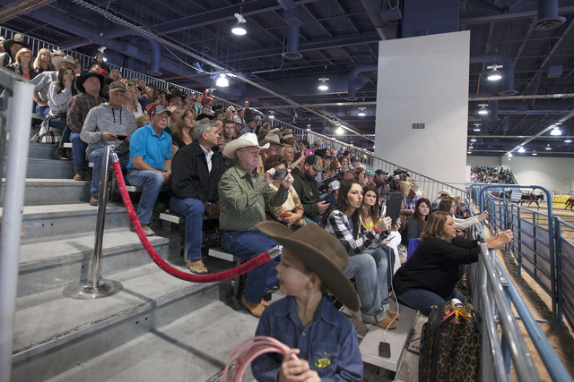The crowd watches the Junior NFR miniature bull riding competition at the Cowboy Christmas gift show in the south halls of the Las Vegas Convention Center on Sunday, Dec. 4, 2016, in Las Vegas. (R ...