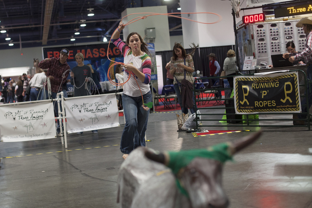 Cheyanne Gleave, 15, ropes a decoy steer at the Three Amigos Super Steer Roping booth in the south halls of the Las Vegas Convention Center on Sunday, Dec. 4, 2016, in Las Vegas. (Rachel Aston/Las ...