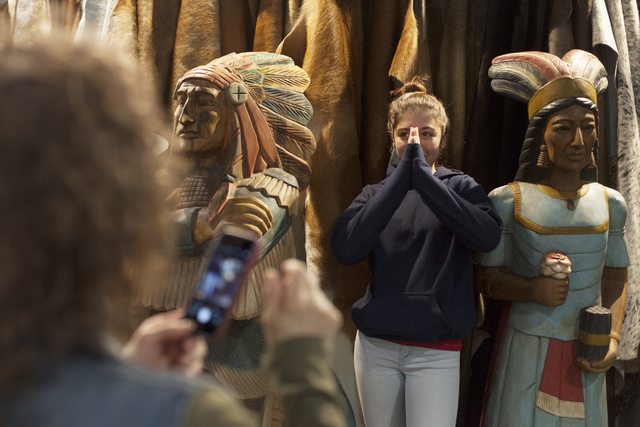 Margaret Garofano takes a photo of her granddaughter Olivia Dellabella, 13, among statues for sale in the south halls of the Las Vegas Convention Center on Sunday, Dec. 4, 2016, in Las Vegas. (Rac ...
