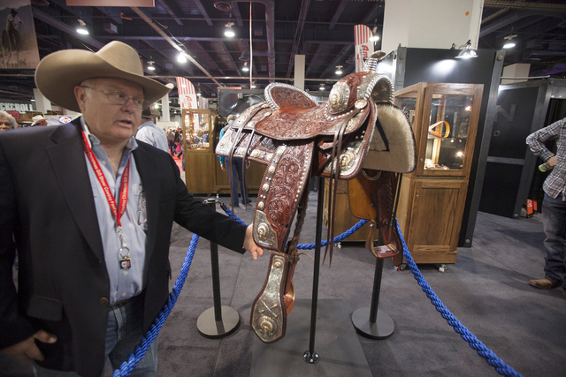 David K. Marold, President and CEO of Bohlin Company, shows off a saddle worth $219,500 and took 1500 hours to make, in the south halls of the Las Vegas Convention Center on Sunday, Dec. 4, 2016,  ...