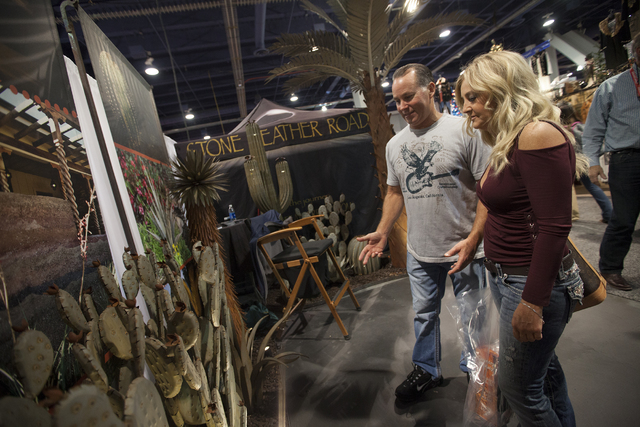 Lou and Tracy Torres admire the metal cactus structures at the Desert Steel booth in the south halls of the Las Vegas Convention Center on Sunday, Dec. 4, 2016, in Las Vegas. (Rachel Aston/Las Veg ...