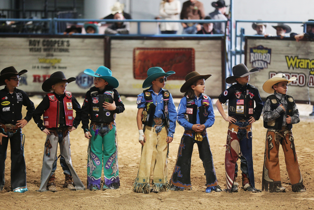 Junior bull riders line up before competing at the Junior NFR competition in the south halls of the Las Vegas Convention Center on Sunday, Dec. 4, 2016, in Las Vegas. (Rachel Aston/Las Vegas Revie ...