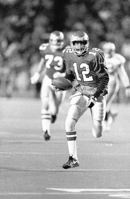 Philadelphia Eagles quarterback Randall Cunningham runs for a fourth quarter touchdown against the Green Bay Packers in NFL game at Philadelphia's Veterans Stadium on Sunday, Dec. 16, 1990. ...