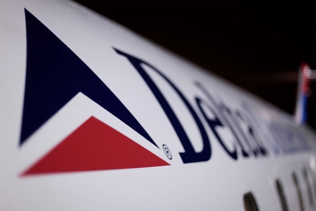 A Delta plane sits on a runway prior to takeoff at John F. Kennedy International Airport in New York December 25, 2009. (Lucas Jackson/Reuters)