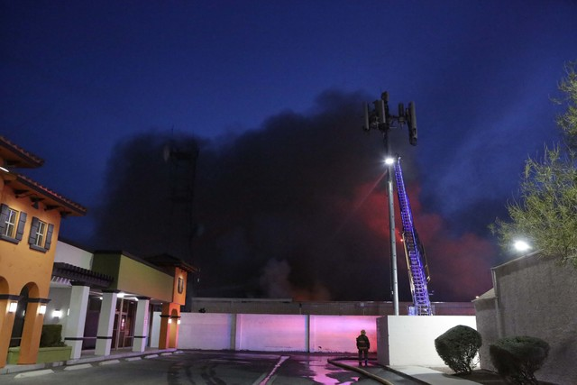 Clark County and Las Vegas firefighters battle a blaze in a vacant building at 3350 E. Desert Inn Road early Wednesday morning, Dec. 14, 2016. (Bizuayehu Tesfaye/Las Vegas Review-Journal) @bizutesfaye