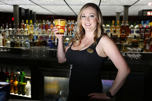 Bartender Liz Olker holds a glass of Mango Maggie at PT's Gold  in Las Vegas, Thursday, Dec. 22, 2016. (Chitose Suzuki/Las Vegas Review-Journal) @chitosephoto