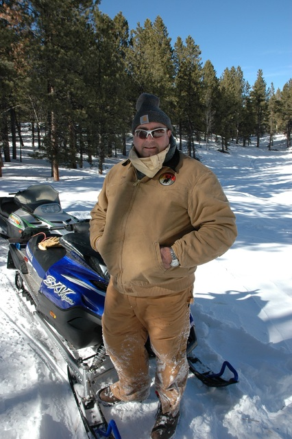 Snowmobiles make easy work of traveling in snow country. When the ice is thick enough they can be used to carry and angler and his gear. Battle the cold by wearing layers of clothing. Photo by Dou ...