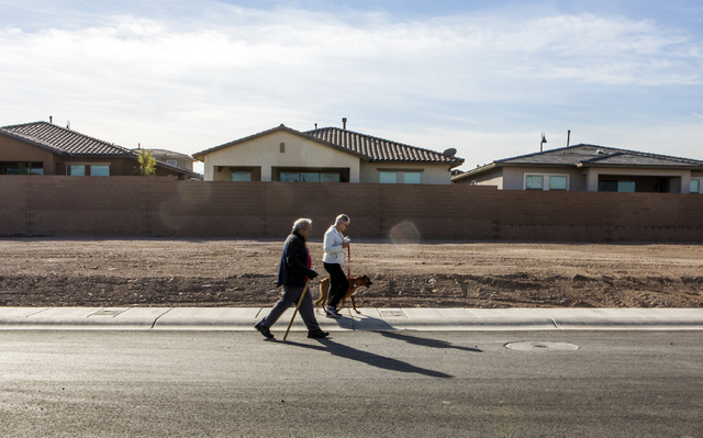 A couple walk a dog at Cadence, a 2,300-acre master planned community, waiting to be developed in Henderson on Tuesday, Dec. 13, 2016. (Jeff Scheid/Las Vegas Review-Journal) Follow @jeffscheid