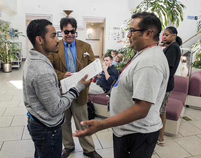 Clark County precinct team leader Allan Guitierrrez, left, asks a man to leave after he tried to hand out democratic election sample ballots at the North Las Vegas Airport voting station on Tuesda ...