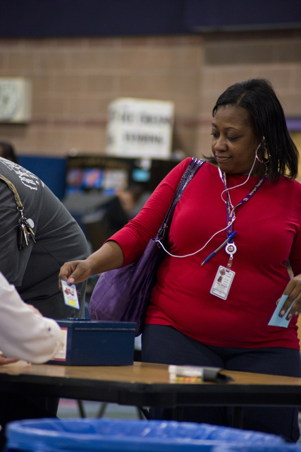 Yerie Williams returns her voting machine card after casting her ballot at the polling location inside Liberty High School in Henderson on Tuesday, Nov. 8, 2016. (Daniel Clark/Las Vegas Review-Jou ...