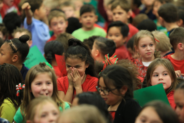 A students laughs while Santa talks at C.T. Sewell Elementary School in Henderson on Friday, Dec. 16, 2016. Gifts that were given out were donated by Bob and Sandy Ellis, who have donated more tha ...