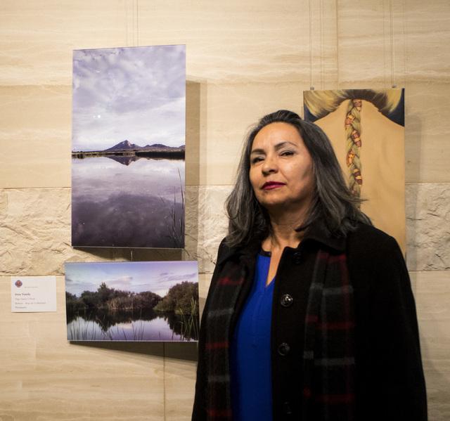 Irma Varela shows off her art during a city employee art exhibit at Las Vegas City Hall on Thursday, Dec. 8, 2016. (Miranda Alam/Las Vegas Review-Journal) @miranda_alam