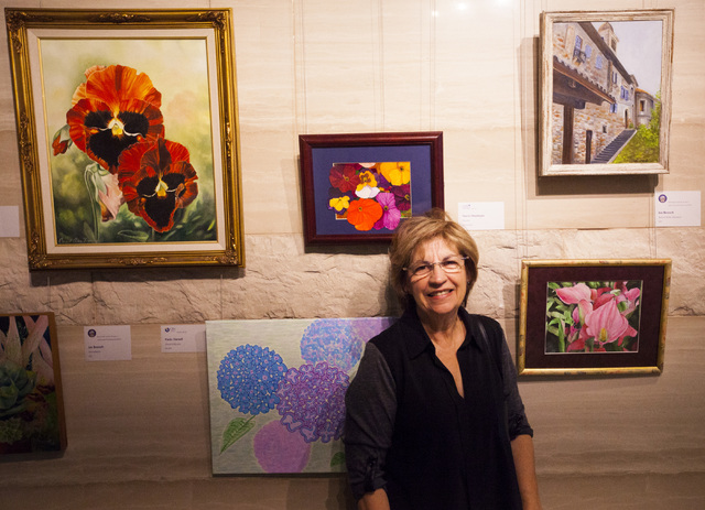 Jan Bennett shows off her art during a city employee art exhibit at Las Vegas City Hall on Thursday, Dec. 8, 2016. (Miranda Alam/Las Vegas Review-Journal) @miranda_alam