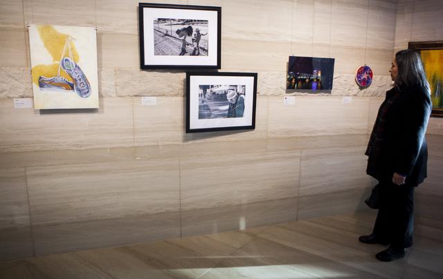 Contributing artist Irma Varela during a city employee art exhibit at Las Vegas City Hall on Thursday, Dec. 8, 2016. (Miranda Alam/Las Vegas Review-Journal) @miranda_alam