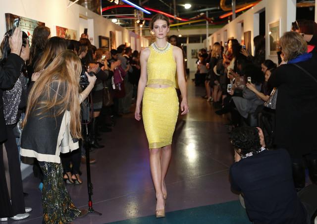 A model presents a creation by local fashion designer Ermelinda Manos during Manos' fashion show at the Metropolitan Gallery Art Museum in Las Vegas, Wednesday, Dec. 7, 2016. (Chitose Suzuki/Las V ...