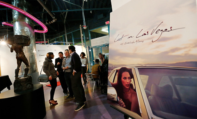 People attend a book party and a fashion show for local fashion designer Ermelinda Manos at the Metropolitan Gallery Art Museum in Las Vegas, Wednesday, Dec. 7, 2016.  Manos released an art book c ...