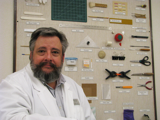 Michael Frazier, conservator at UNLV Special Collections, is tasked with preservation and conservation of collection at Lied Library at UNLV, 4505 S. Maryland Parkway. His lab includes hand tools  ...