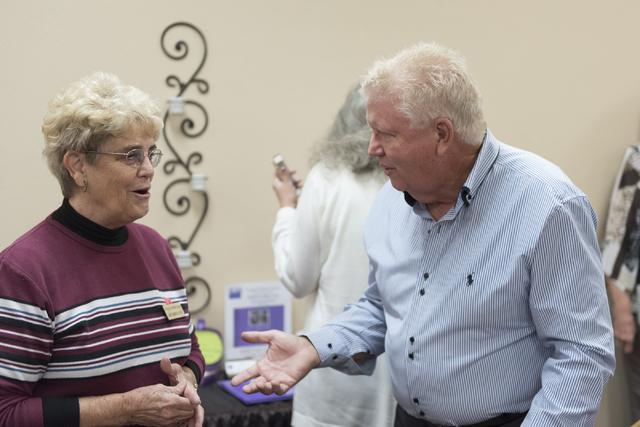 Ken Stewart, great-great-great-grandson of Helen J. Stewart, right, mingles with League of Women Voters meeting attendees at University United Methodist Church in Las Vegas, Saturday, Nov. 19, 201 ...